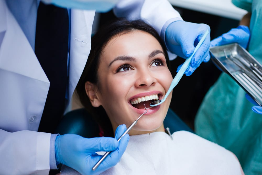 woman getting dental services