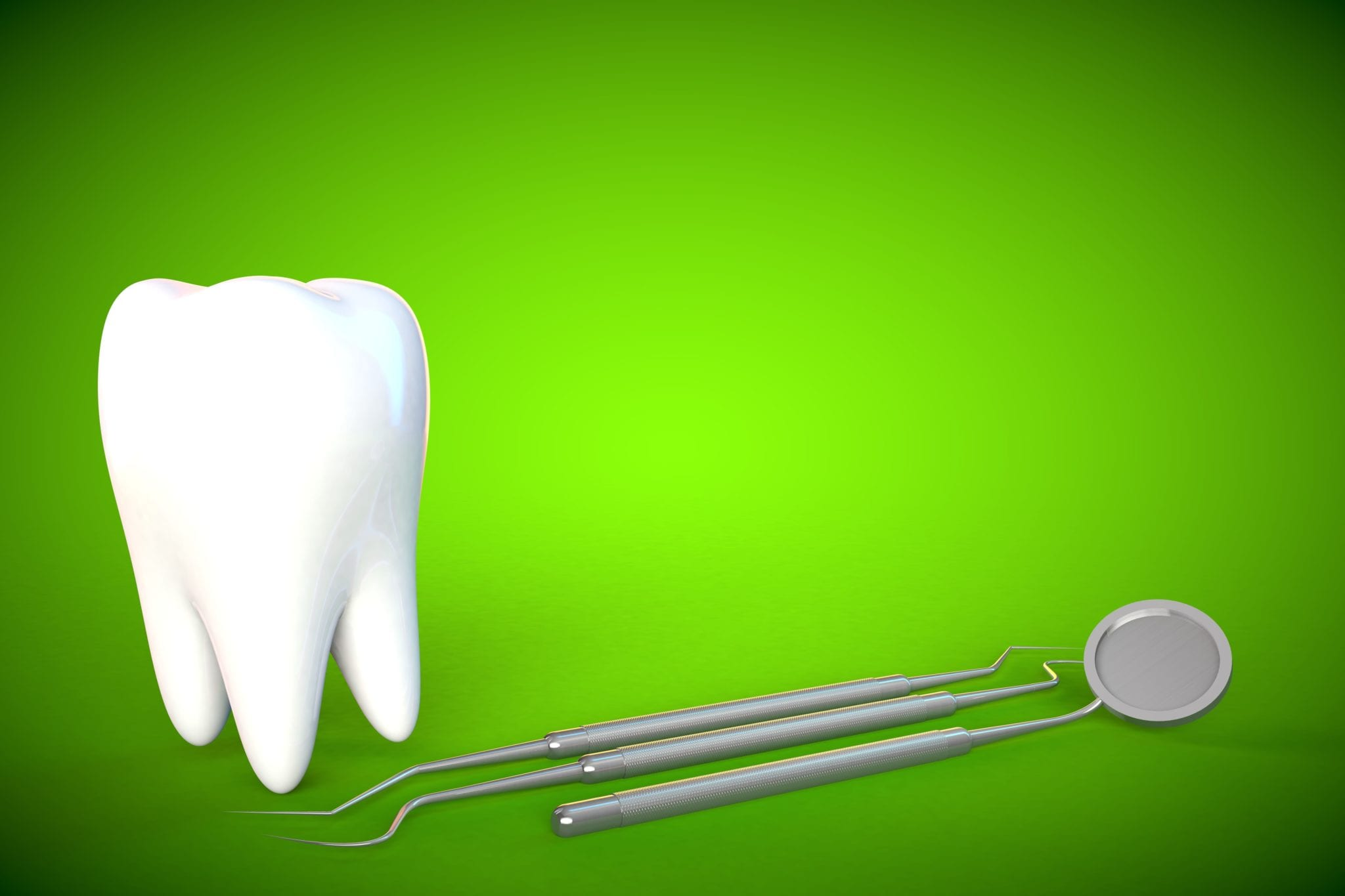 Giant tooth and dental mirror on a green background