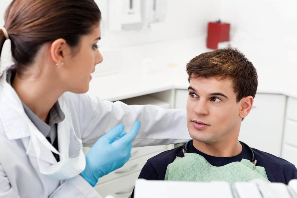 Dentist and patient talking